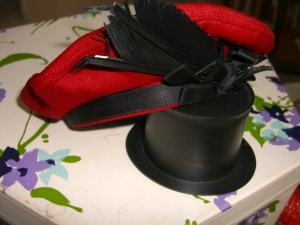 red felt hat with large black feathers ©booksandbuttons