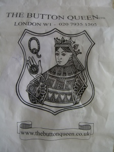 the paper bag from The Button Queen shop in London