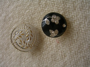 glass pretties from The Button Queen, black one about an inch in d.